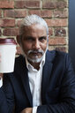 Portrait of bearded senior businessman with coffee to go - IGGF00644