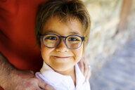Portrait of smiling little boy wearing glasses - VABF01625