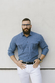 Portrait of bearded hipster businessman wearing glasses and plaid shirt - FMGF00012