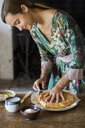 Young woman cutting home-baked cake - ALBF00598