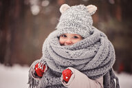 Portrait of a young girl wearing a winter hat, scarf and gloves - INGF00023