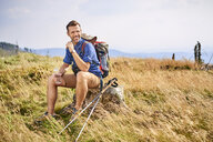 Smiling man resting during hiking trip - BSZF00678