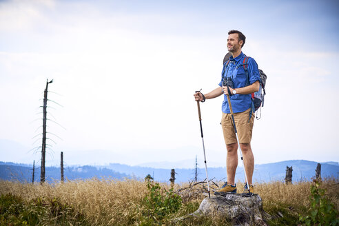 Man admiring the view during hiking trip - BSZF00687