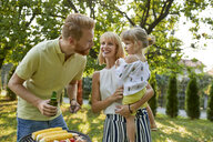 Family having a barbecue in garden - ZEDF01589