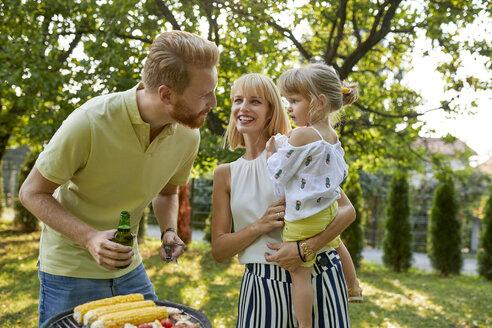Family having a barbecue in garden - ZEDF01589