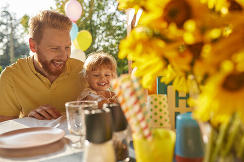 Happy father and daughter on a garden party - ZEDF01604