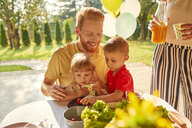 Happy family having a garden party - ZEDF01616