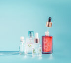 Studio shot of cosmetic products against a blue background - INGF00340