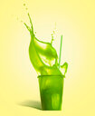 Close-up shot of green drink in a glass - INGF00343