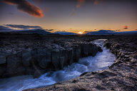 A river flowing through the rocks at sunset - INGF00385