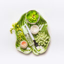 High angle studio shot of green products on a white background - INGF00415