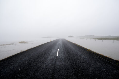 A long road leading towards the fog in Iceland - INGF00421