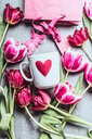 High angle view of pink roses and a heart shaped cup - INGF00439