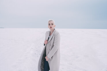 Portrait confident young woman in snowy landscape - FSIF03180