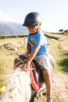 Spain, Cerdanya, little boy riding on pony - VABF01633