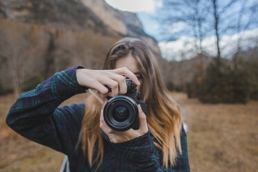 Spain, young woman with camera in Ordesa National Park - AFVF01640