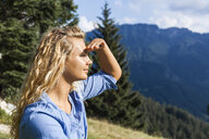 Germany, Bavaria, Oberammergau, young woman on a hiking trip looking at view - TCF05839