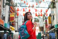 Tourist sightseeing in Chinatown, Kuala Lumpur, Malaysia - CUF45307