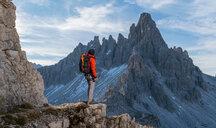 Hiker enjoying view, Dolomites near Cortina d'Ampezzo, Veneto, Italy - CUF45415