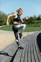 Young woman exercising on steps - CUF45631