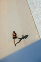 Young woman running on road - CUF45655