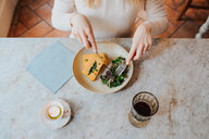 Woman having vegan meal in restaurant - CUF45871