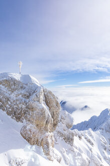 Germany, Bavaria, Zugspitze, summit cross in winter - MMAF00628
