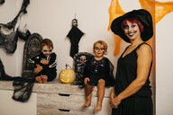 Group picture of mother and her two children at Halloween - JRFF01884