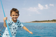 Spain, Little boy having fun on a boat, close to Mallorca - JRFF01903