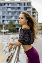 Portrait of beautiful young woman standing on promenade - AFVF01713