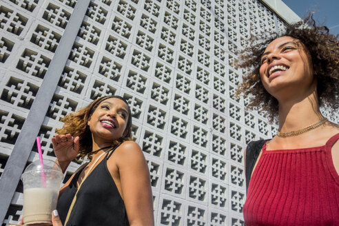 Two young women chatting and laughing, low angle, Los Angeles, California, USA - ISF19967