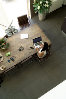 Overhead view of woman using laptop at home - HHLMF00530