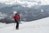 Russia, Upper Baksan Valley, Caucasus, Mountaineer ascending Mount Elbrus - ALRF01285