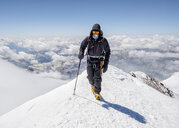 Russia, Upper Baksan Valley, Caucasus, Mountaineer ascending Mount Elbrus - ALRF01300