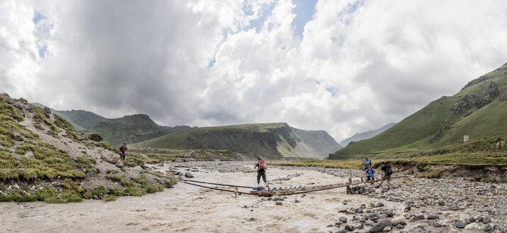Russia, Caucasus, Mountaineers crossing river in Upper Baksan Valley - ALRF01312