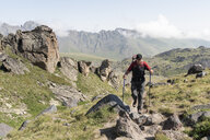 Russia, Caucasus, Mountaineer hiking in Upper Baksan Valley - ALRF01318