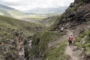 Russia, Caucasus, Mountaineers hiking in Upper Baksan Valley - ALRF01327