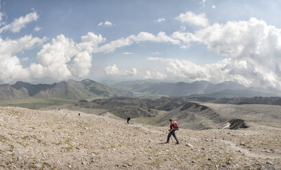 Russia, Caucasus, Mountaineers hiking in Upper Baksan Valley - ALRF01348