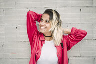 Smiling young woman portrait, Spain. - RAEF02172