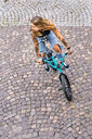 Young woman riding her BMX bike - STSF01762