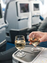 Alcoholic beverage as part of the service in business class of an airplane - ABAF02214