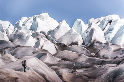 Man exploring Qualerallit glacier, Narsaq, Kitaa, Greenland - CUF46050