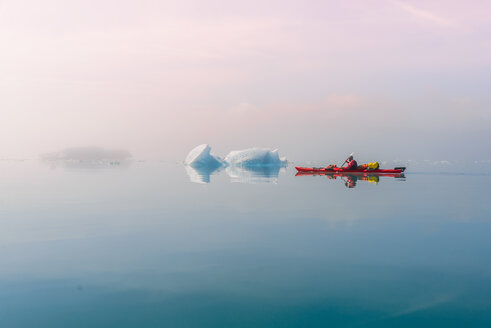 Man sea kayaking in fjord, Narsaq, Kitaa, Greenland - CUF46053