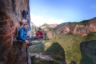 Portrait of two rock climbers on portaledge, Liming, Yunnan Province, China - CUF46056