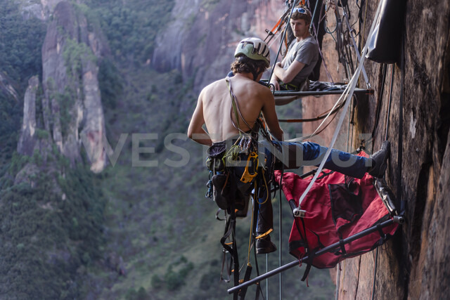 Rock climber securing portaledge, Liming, Yunnan Province, China - CUF46062
