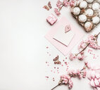 High angle view of pink and white objects on a table - INGF00470