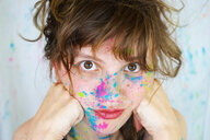 Young cute woman with paint in her face - INGF00746