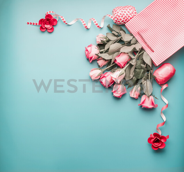 High angle view of roses in a striped bag - INGF00779
