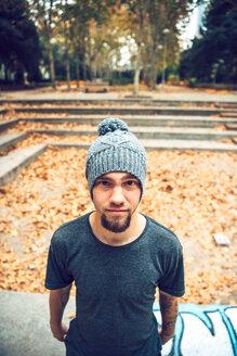 Portrait of bearded freerunner in park - INGF00845