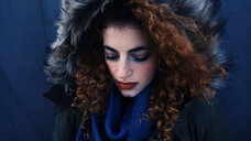Close-up portrait of young woman with curly hair - INGF01169